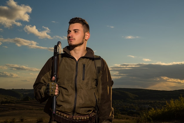 Young hunter. american hunting rifles. hunting without borders. hunter with shotgun gun on hunt. portrait of handsome hunter