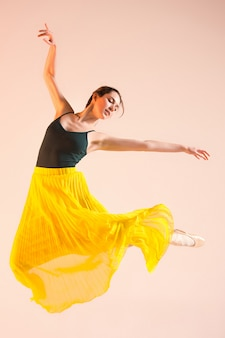Young and incredibly beautiful ballerina is dancing at studio
