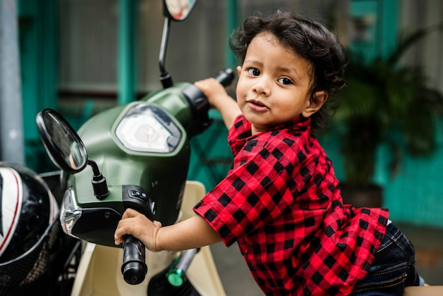 Young indian boy riding the motorbike