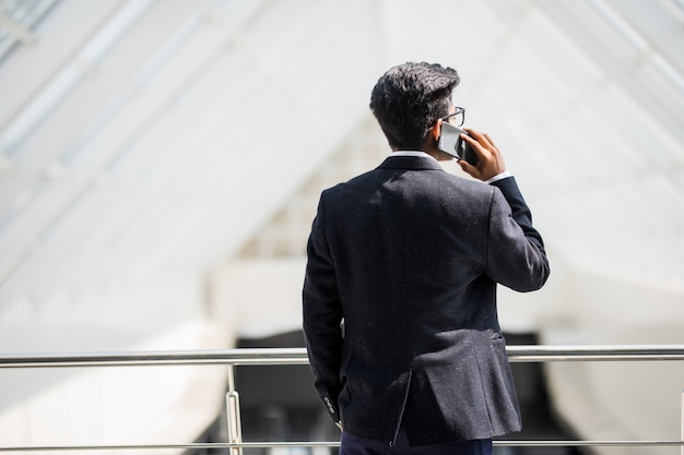 Young indian business man on a phone on the phone