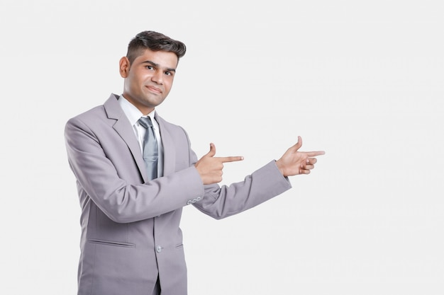 Young indian business man showing direction with hand