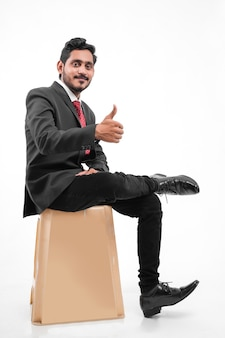 Young indian business man showing thumps up