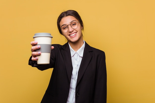 Young indian business woman drinking a takeaway coffee isolated