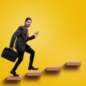 Young indian businessman climbing the stairs