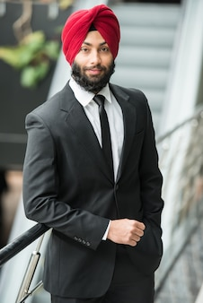 Young indian businessman in turban is posing