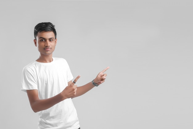 Young indian college student showing direction