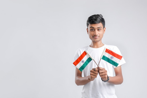 Young indian college student with indian flag.