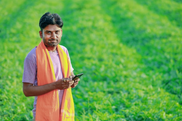 Young indian farmer at field.