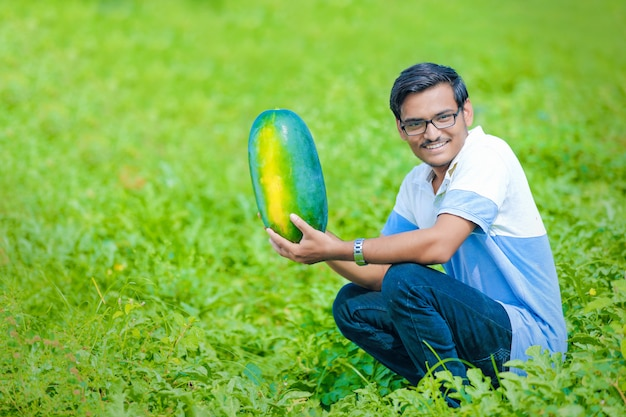 Young indian farmer at watermelon field