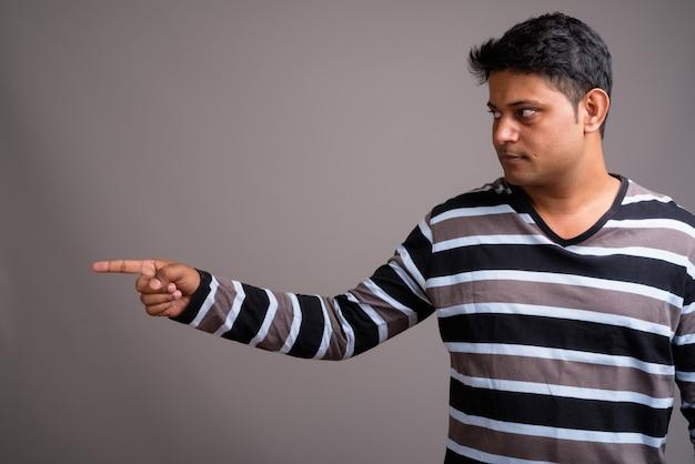 Young indian man wearing striped long sleeve shirt