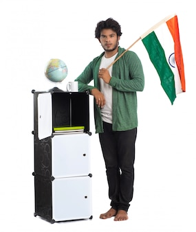 Young indian man with the flag on white background