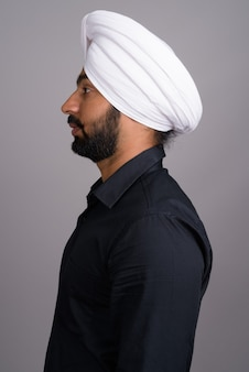 Young indian sikh businessman wearing white turban