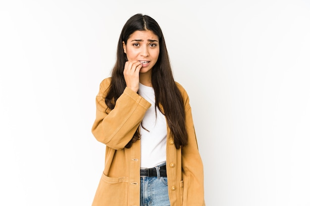 Young indian woman biting fingernails, nervous and very anxious.