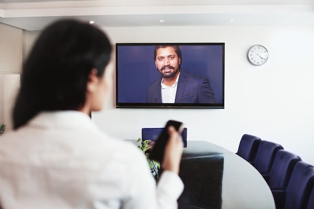 Young indian woman doing video conference with director the company
