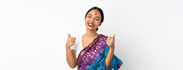 Young indian woman isolated on white background giving a thumbs up gesture