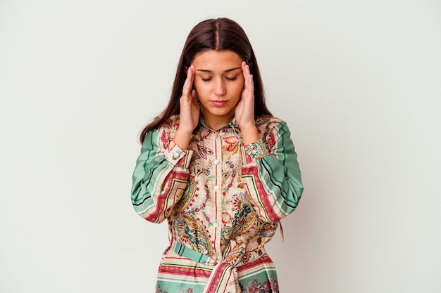 Young indian woman isolated on white background touching temples and having headache.