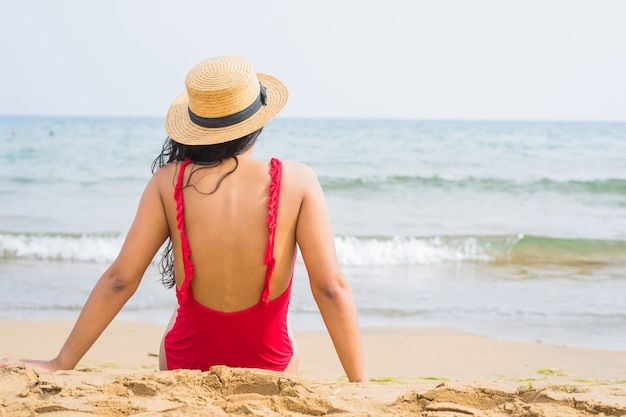 Young indian woman looking sea on the beach