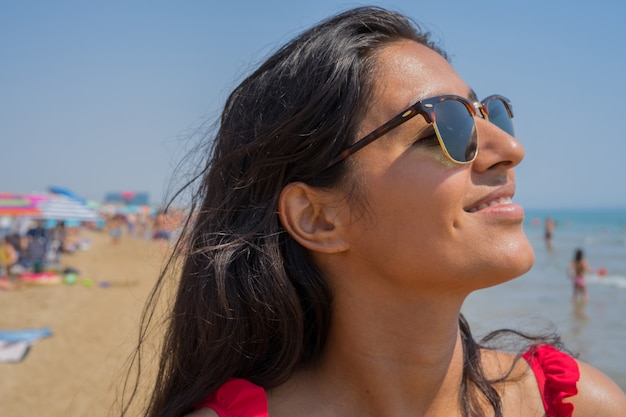Young indian woman relaxed on the beach