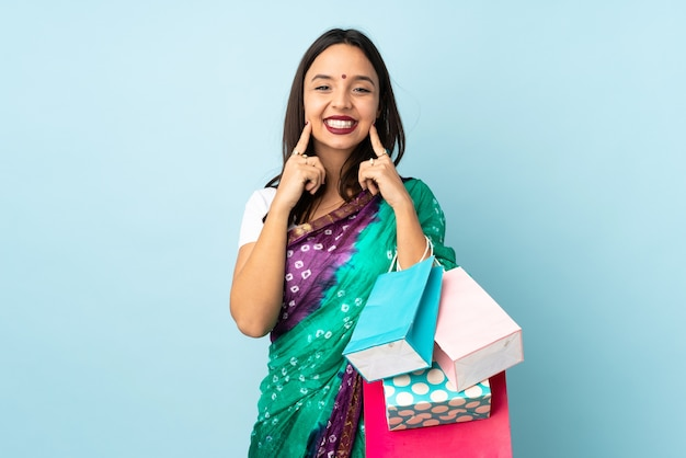 Young indian woman with shopping bags