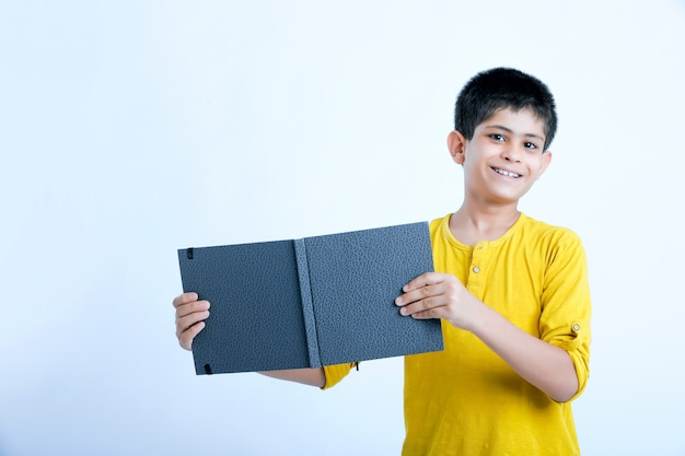 Young indin boy holding a notebook