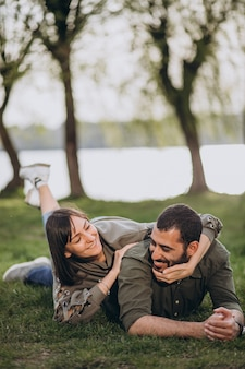 Young international couple together in park
