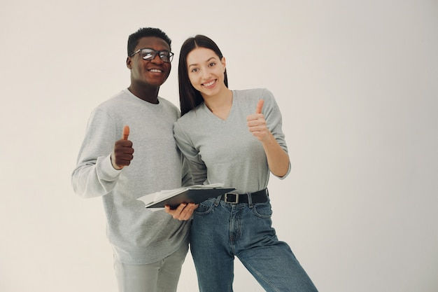 Young international couple working together and use tablet