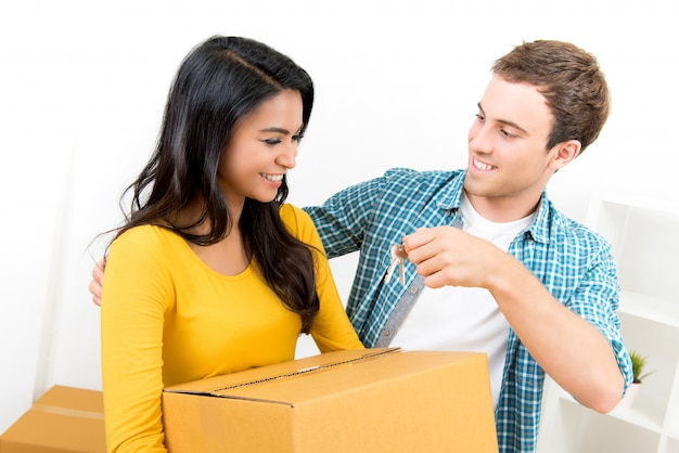Young interracial couple just moving into new house