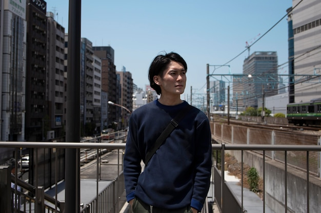 Young japanese man spending time outdoors