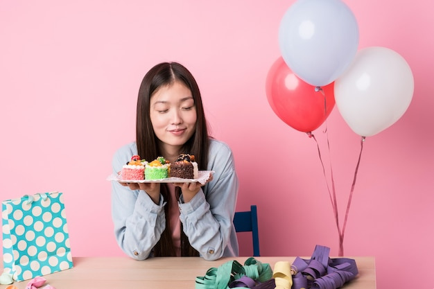 Young japanese woman preparing a birthday party