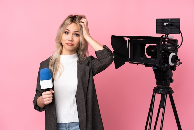 Young journalist woman over isolated background