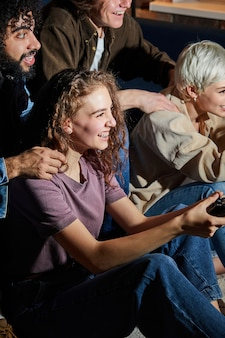 Young ladies playing game console at home at weekends in the evening, dressed casually, having leisure time. hobby, games, people lifestyle concept