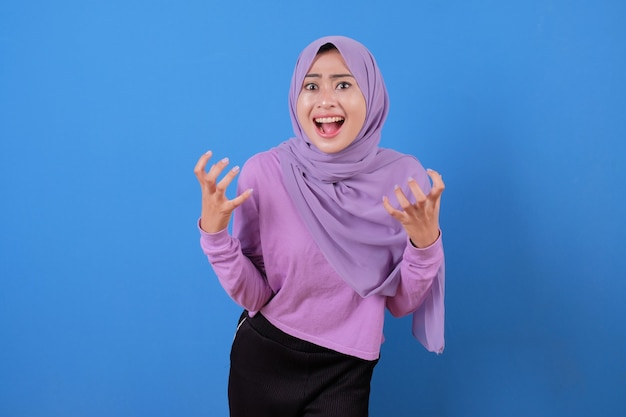 Young lady beautiful muslim shout something with her hands