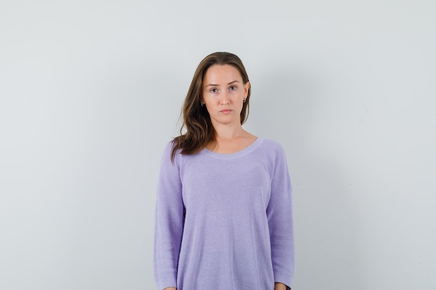 Young lady looking at camera in casual shirt and looking cute