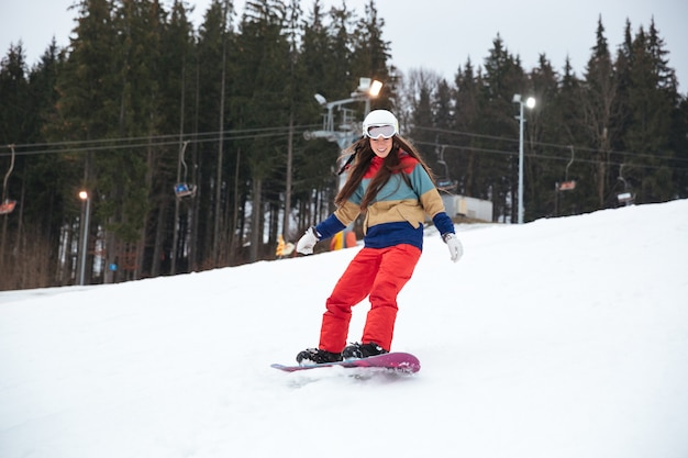 Young lady snowboarder on the slopes frosty winter day