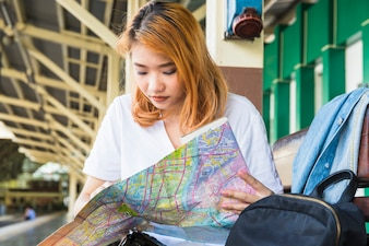 Young lady with map on platform