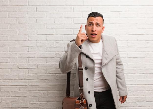 Young latin business man having an idea, inspiration