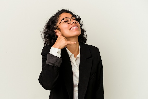 Young latin business woman isolated on white background showing a mobile phone call gesture with fingers.