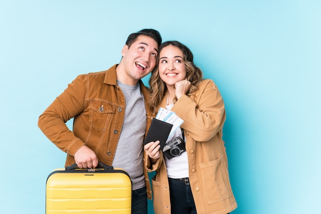 Young latin couple ready for travelling
