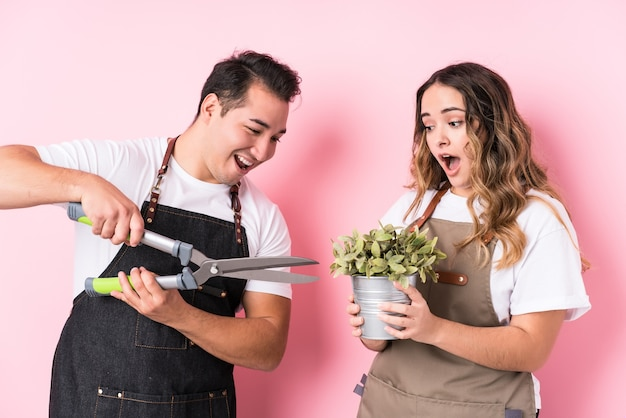 Young latin gardeners in love couple