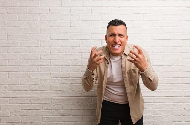 Young latin man angry and upset
