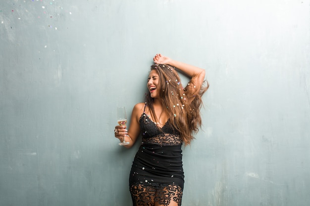 Young latin woman celebrating new year or an event