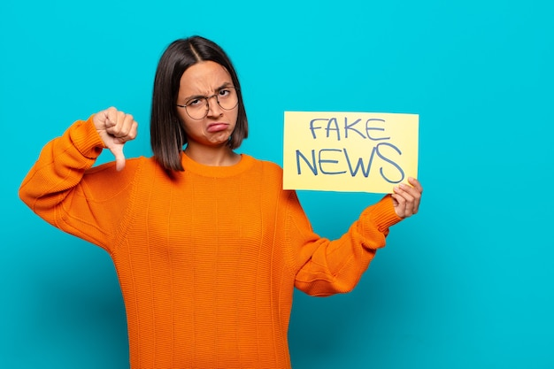 Young latin woman fake news concept