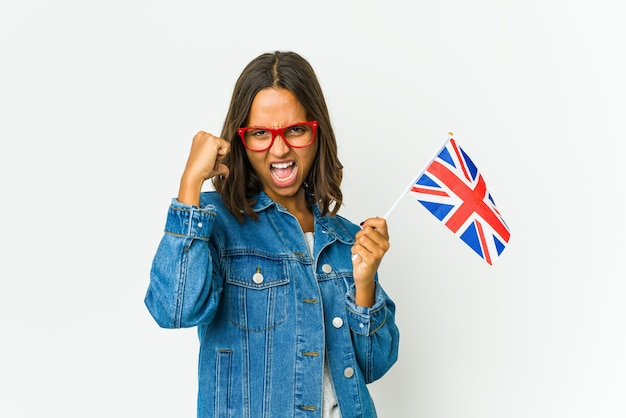 Young latin woman holding a english flag isolated on white wall feels proud and self confident, example to follow.