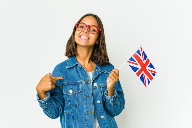 Young latin woman holding a english flag points down with fingers, positive feeling.