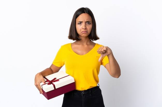Young latin woman holding a gift
