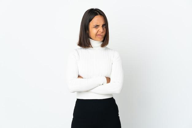 Young latin woman isolated on white background feeling upset