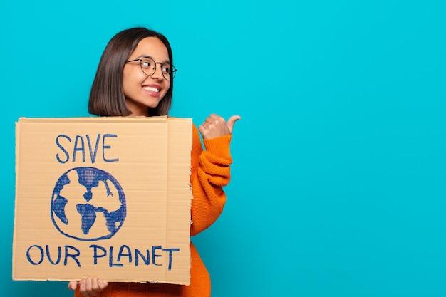 若いラテン女性。世界を救え