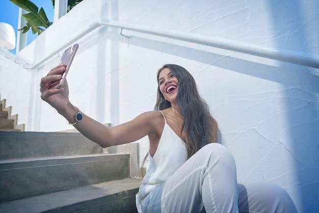 Young latin woman selfie photo smarphone