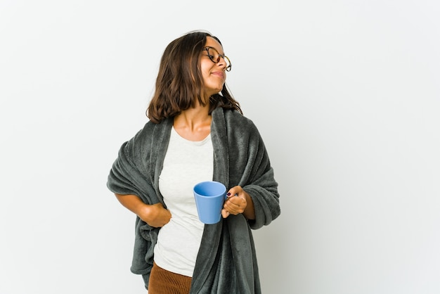 Young latin woman with blanket dreaming of achieving goals and purposes