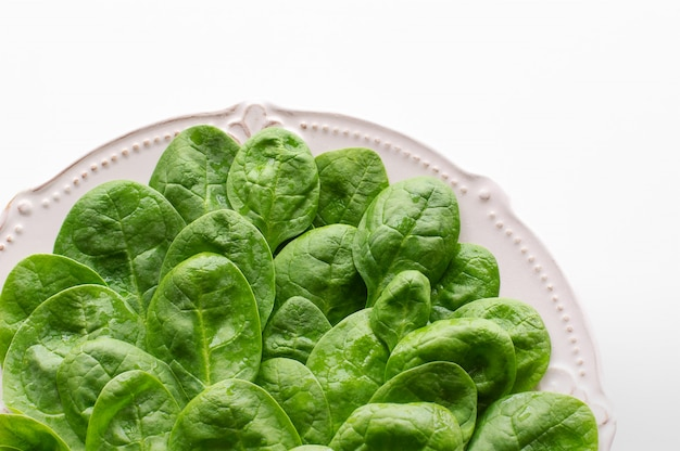 Young leaves of spinach on a plate.